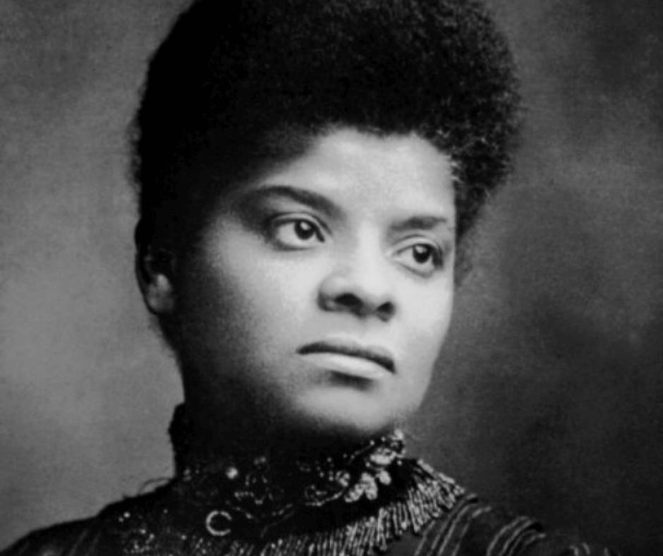 A head and shoulders black & white photo (portrait) of Ida B. Wells.