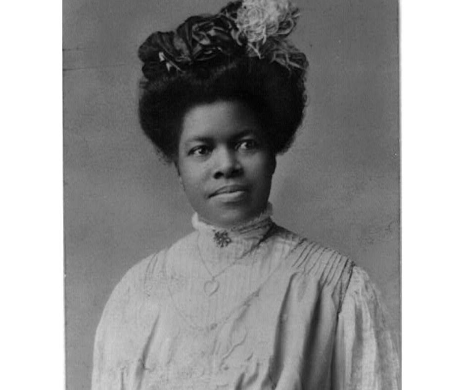 A black & white photographic portrait of Nannie Helen Burroughs.
