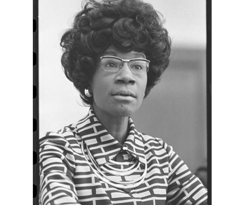 A black & white head and shoulders photo portrait of Congresswoman Shirley Chisholm as she announces her candidacy for presidential nomination in 1972.