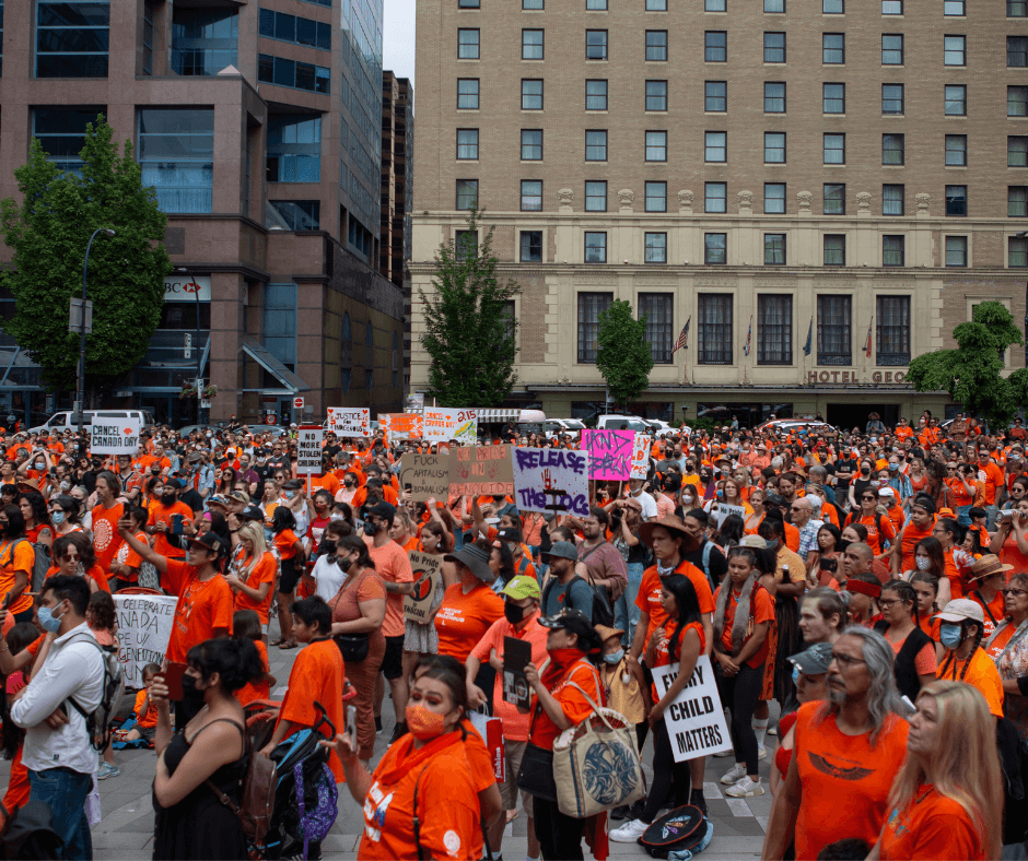 A photo by GoToVan taken on May 30th 2021 of an Orange Shirt Day memorial march for the recently discovered remains of 215 Indigenous children found in unmarked graves on the grounds of the former Kamloops Indian Residential School.