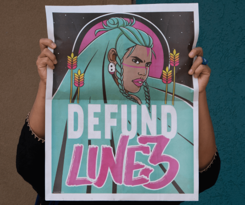 A poster from the Chase Bank, Stop Funding Line 3 Tar Sands Pipeline protest has a graphic design of an Indigenous woman with green hair surrounded by wild rice motifs and the words 'Defund Line 3'. Photo by Mark Dixon.